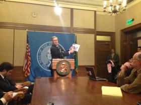 Governor Jay Inslee speaks with reporters at a news conference following the adjournment of the Washington Legislature.