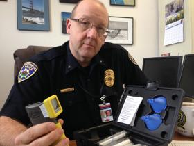 Commander Jim Rich of the Centralia Police Department displays the breath test machine used for the 24/7 Sobriety pilot program.
