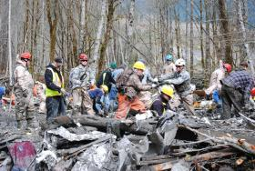 Washington National Guard searchers are assisting in the effort to locate victims of the Oso landslide in Snohomish County.