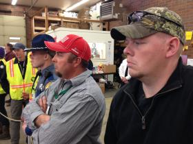 Christian Johnson, right, waits at the Oso firehouse for President Obama to speak. Johnson was a volunteer searcher after the landslide last month.
