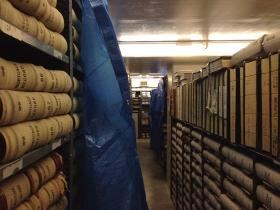 Blue tarps protect historic records from flood waters dripping down from above at the Washington State Archives in Olympia.