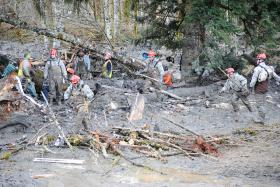 Members of the Washington National Guard search the Oso landslide.