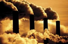 Tiny particles from coal smoke stacks float up in the air.