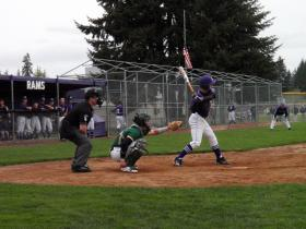 Players at this Timberline vs. North Thurston High School baseball showdown had the option to use an axe bat, but stayed traditional.