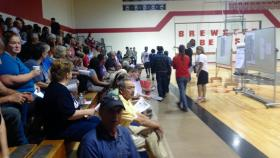 Community members file in Sunday night to a meeting in Brewster, Washington.