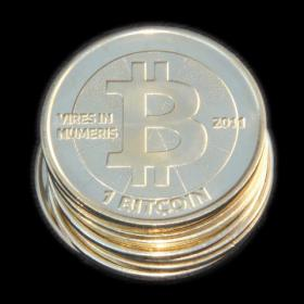 A physical representation of Bitcoin, a digital currency.