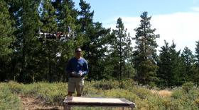 Rheno Prajadipta tests out a drone he helped build with Yakima Valley Community College classmates. The drone will survey the health of the forest. The hope is that drones will speed up restoration efforts and save some money.