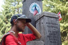 Seattle native Joe McConaughy reached the northern terminus of the Pacific Crest Trail in record time Sunday.