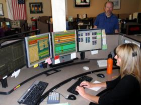Dispatch supervisor Brenda Faxon and director Mark Buchholz in the Willamette Valley 9-1-1 Communications Center in Salem.