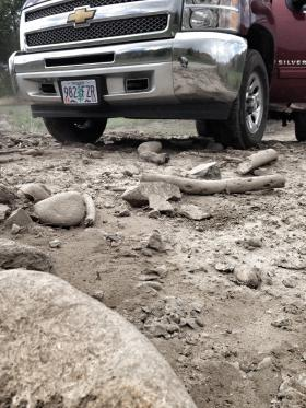 Mud and debris covered driveways and state highways after a major rainstorm and fires hit Okanogan County earlier this summer.