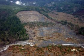 Washington Gov. Jay Inslee's landslide commission began its work Friday with a visit to the site of the deadly Oso landslide.