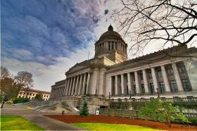 Washington state's Legislative Ethics Board voted Tuesday to allow lawmakers to accept a dozen lobbyist-paid meals per year.
