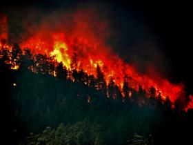 A fire started by lightning near the Oregon-California border has burned more than 10,000 acres in less than 24 hours.