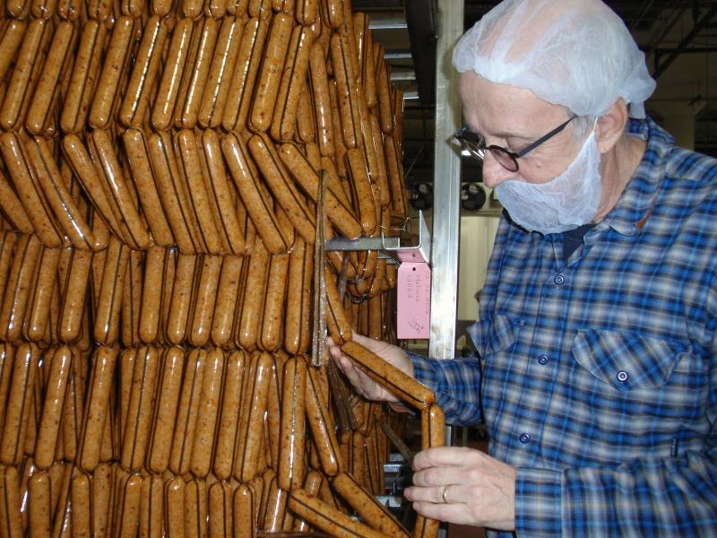 Turtle Island Foods founder Seth Tibbott examines freshly made Tofurky Italian sausages.