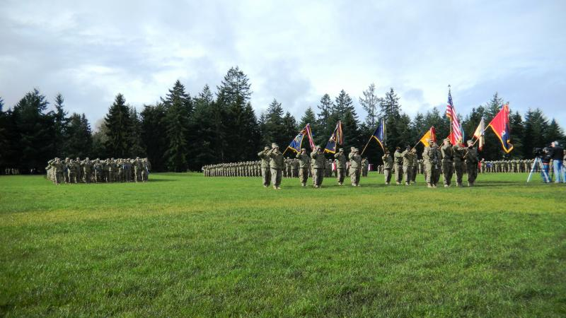 "Members of the 2nd Stryker Brigade at Joint Base Lewis-McChord prepare to ""case"" their flags in preparation for a nine month deployment to Afghanistan."