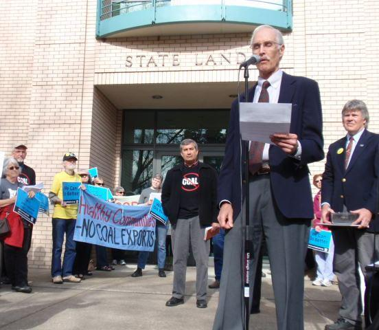 Andy Harris with the group Physicians for Social Responsibility speaks at a rally against coal export terminals outside a meeting of the Oregon State Land Board in Salem.