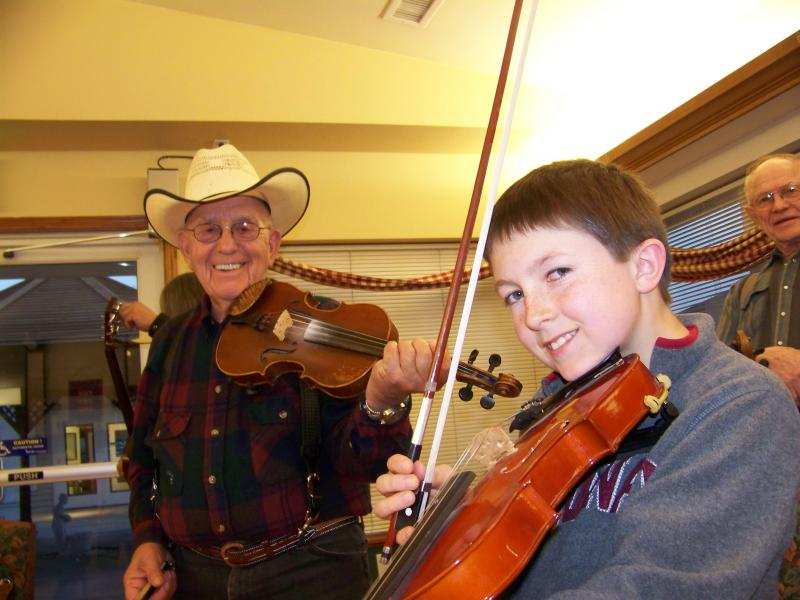 Ruel Teague, 85, takes great joy in teaching young musicians in private lessons and while jamming at the Old Time Fiddlers group most every Friday night somewhere in Burns, Ore.