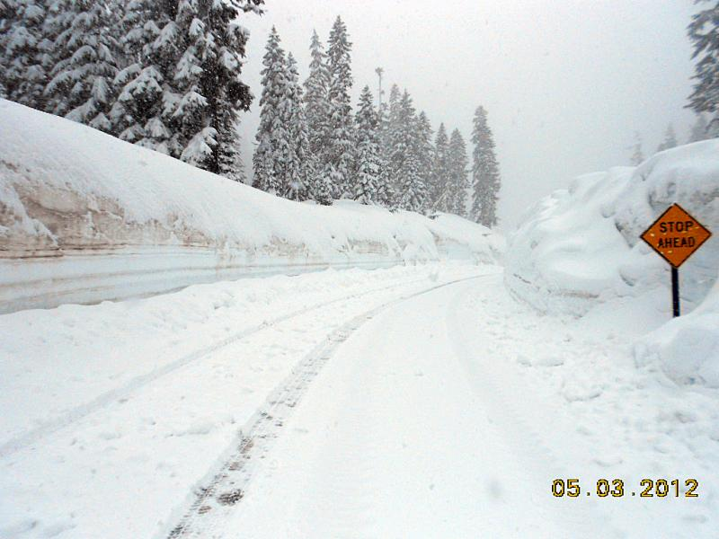 spring snowstorm on Cayuse Pass (SR 123) dumped more than a half-foot of snow on the highway. Crews hoped to open the pass on Friday (May 4), but with snow predicted through the weekend, they've had to push it back.