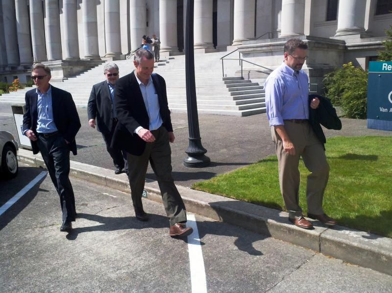 Costco Officials Leave The Washington Supreme Court Following Oral Arguments In A Lawsuit To Repeal I-1183 Privatizing Liquor Sales.