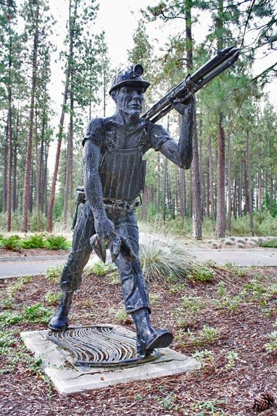 A statue of a miner stands outside Hecla Mining's headquarters in Coeur d'Alene, Idaho. The company owns the Lucky Friday Mine in Mullan, Idaho.