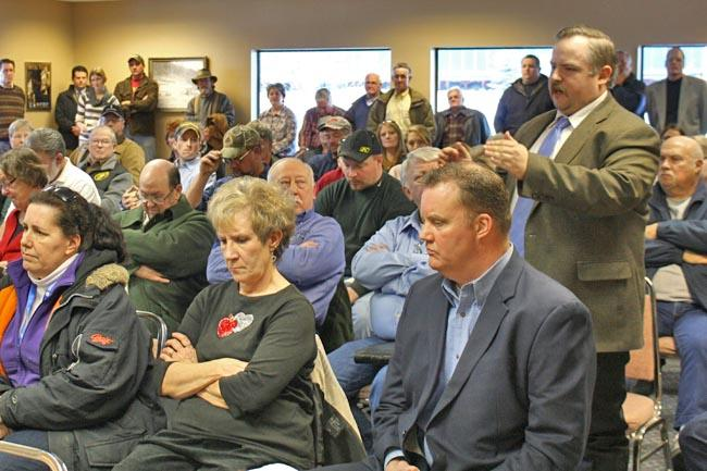 Local attorney James McMillan, standing on right, speaks at a town hall meeting attended by nearly 100 people that Idaho Gov. Butch Otter held Monday in Wallace.