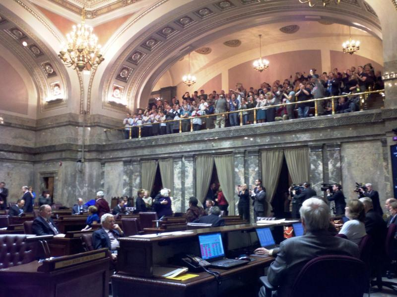 Gay rights supporters applaud after the Washington senate votes to approve same-sex marriage.
