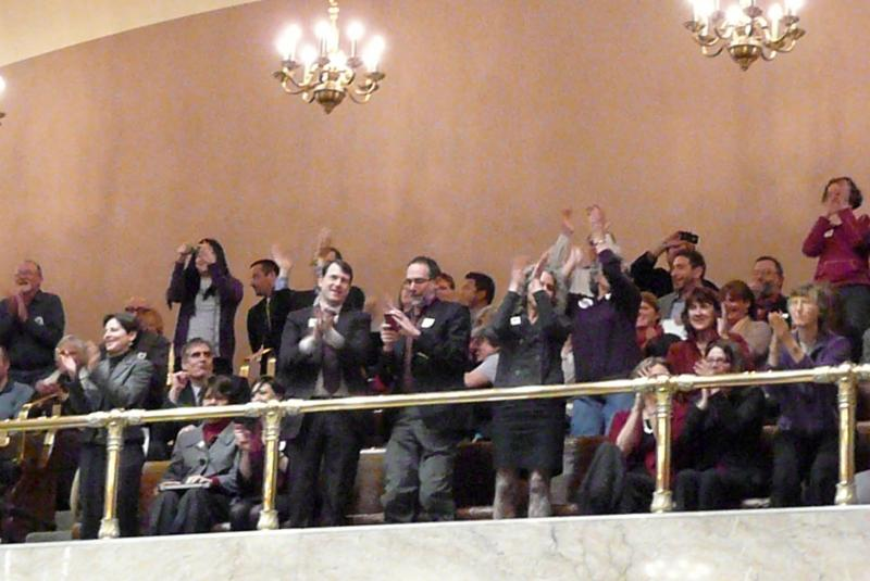 Crowd cheering passage of gay marriage law.
