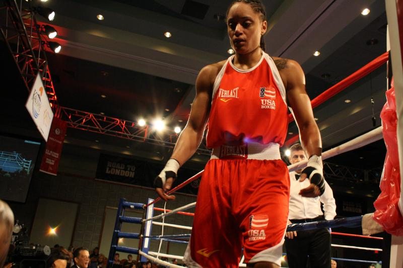 Queen Underwood, 27, of Seattle steps out of the ring victorious at the Olympic team trials for women's boxing in Spokane.