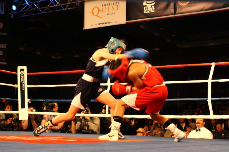 Queen Underwood, in red, fights Mikaela Mayer to win the lightweight championship at the Olympic team trials for boxing in Spokane.