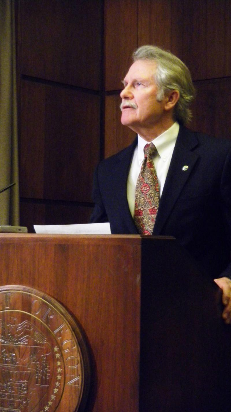 Governor John Kitzhaber speaks at a state capitol press conference.