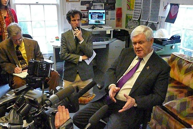 Presidential candidate Newt Gingrich speaks with statehouse reporters in Olympia, Wash.