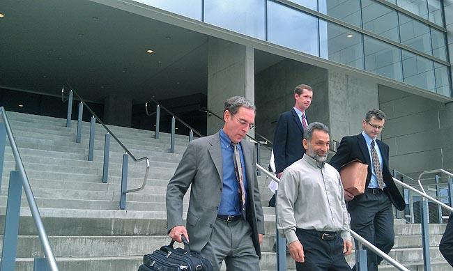 Pete Seda, (center) and his attorney Steven Wax (left) leave the Federal Courthouse in Eugene following his sentencing hearing. (2010)