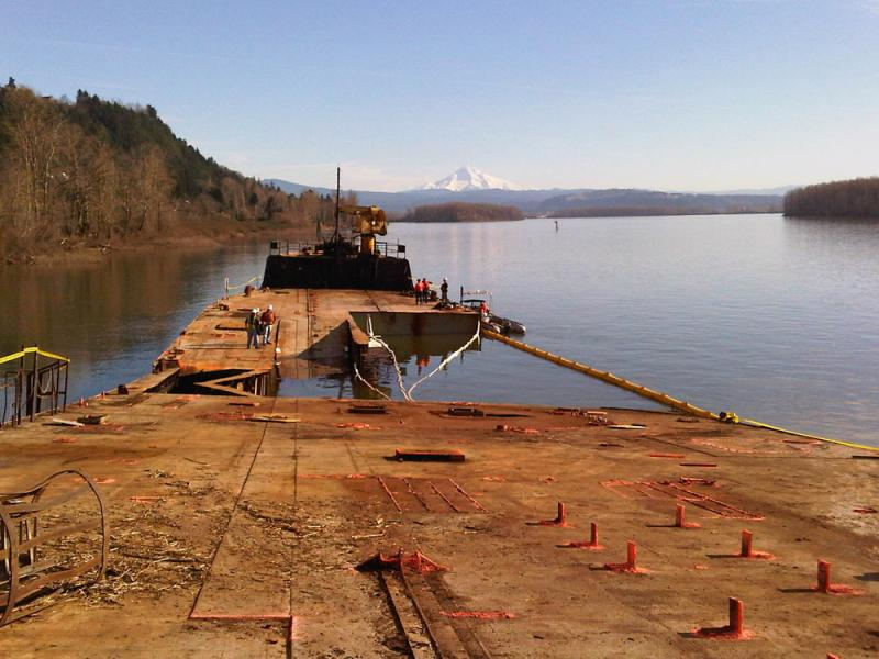 The 431-foot barge, Davy Crocket, sits aground on the northern bank of the Columbia River near Camas, Wash., Thursday, Jan. 27, 2011.