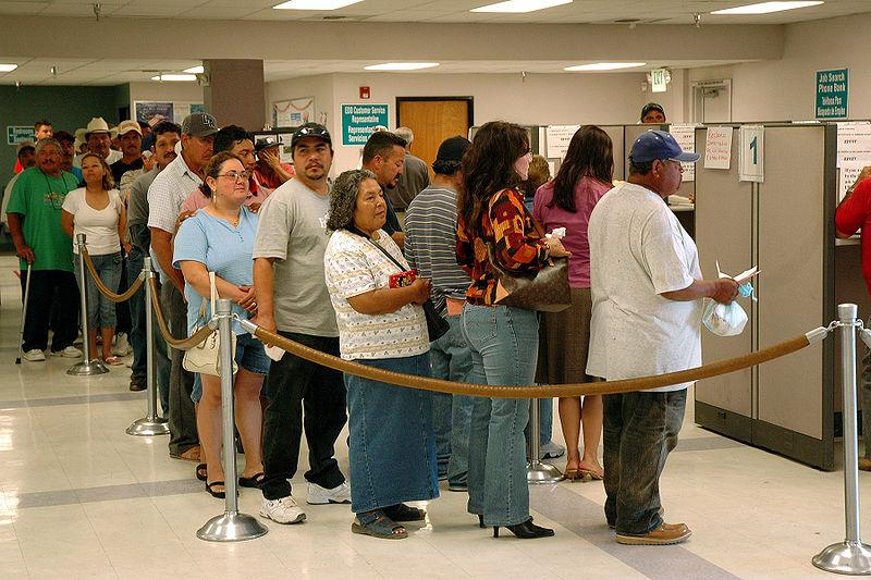 Unemployed workers wait in line.