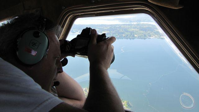 Christopher Krembs, an oceanographer with the Washington Department of Ecology, photographs algae in Puget Sound.