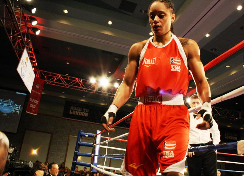 Seattle's Queen Underwood, 28, exits the ring in Spokane, Wash., after qualifying for the U.S.A. team for the first women's Olympic boxing tournament.