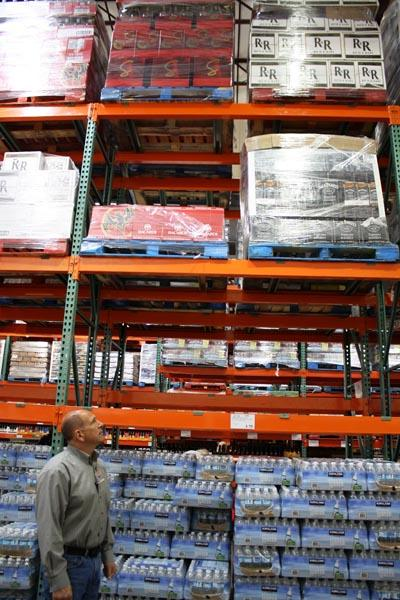 Spokane Costco manager Kelly Frisina looks up at the pallets of liquor ready to be lowered after midnight on Friday morning.