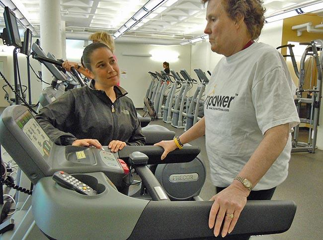Trainer Laura Rosencrantz (left) developed a personalized training program for cancer patient Trish Carr (right).
