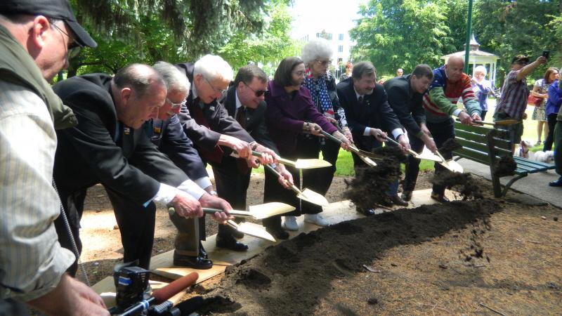 Officials break ground for a World War II memorial in Salem.