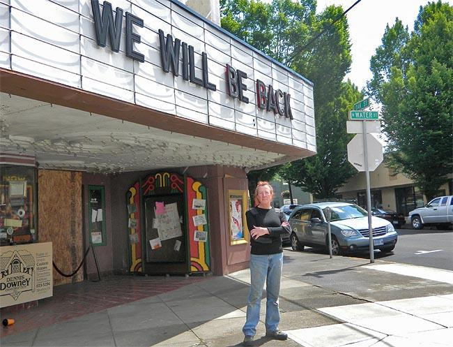 Palace Theatre co-owner Stu Rasmussen stands in front of the boarded-up front entrance to his Silverton, Oregon movie house.
