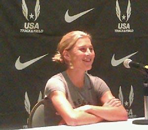 Lauren Fleshman speaks with reporters in Eugene.