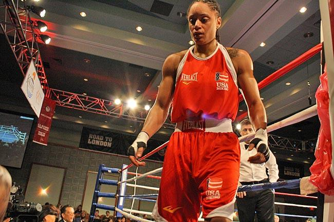 Queen Underwood leaves the ring after winning her final round at the trials in Spokane, earning a spot on the USA's first women's Olympic boxing team.