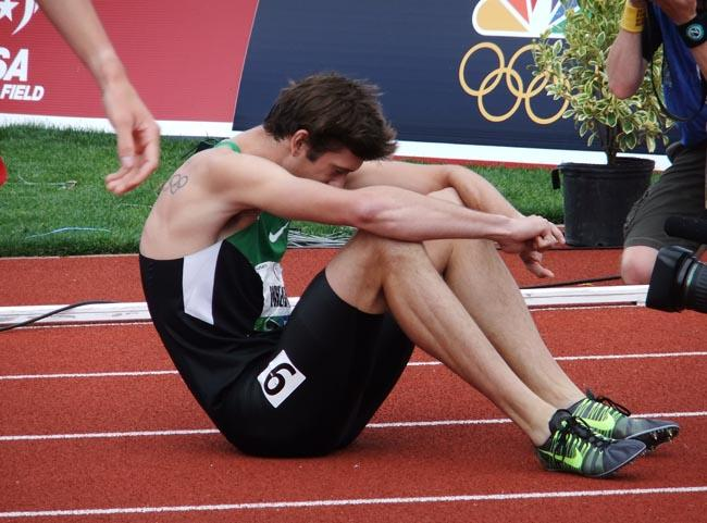 Andrew Wheating collapses on the track after the men's 1,500-meters.