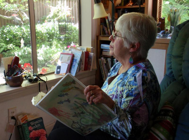 Joan Rupp of Tacoma counts and records bird sightings outside her living room window as part of Project FeederWatch.