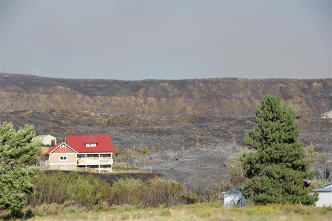 The Taylor Bridge fire near Ellensburg, Wash., has burned more than 60 structures, but some residents have not evacuated.