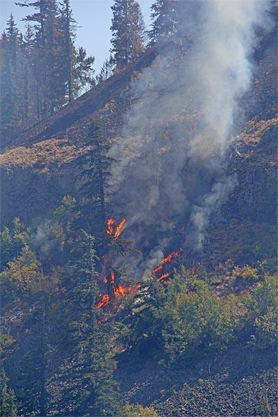 The last open stretch of the Taylor Bridge fire is in especially steep, rocky terrain.