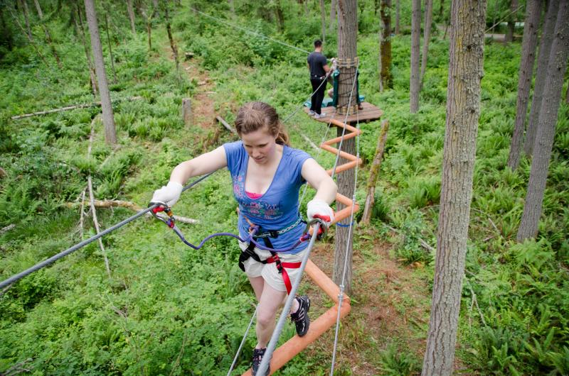 Some zip line courses -- like this one at Northwest Trek -- add aerial challenges between the various zip descents.