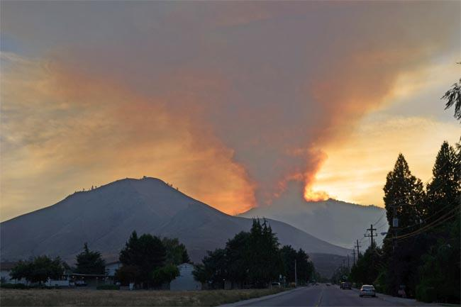 Smoke billows from a lightning-sparked fire in the hills outside Wenatchee, Wash.