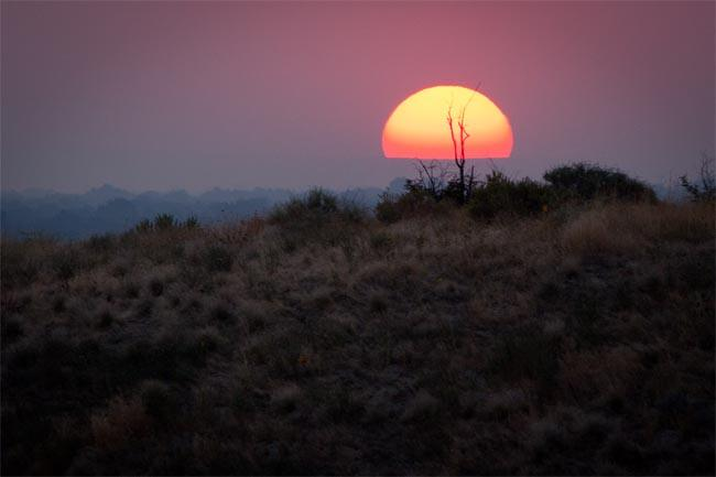 Smoke from wildfires can create some spectacular sunsets, like this one near Boise, Idaho.
