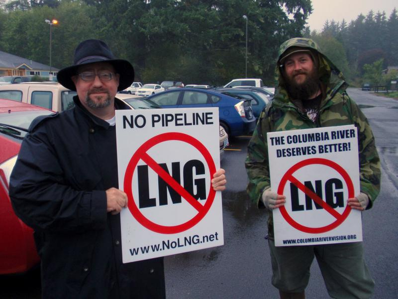 Portland attorney Robert Lorey (left) and Astoria marine biologist Dave Lillis protest natural gas exports outside the Warrenton Community Center